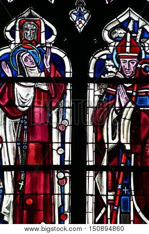 Poissy, France - august 6, 2016 : stained glass window of the historical collegiate church where the king Saint Louis was baptised.