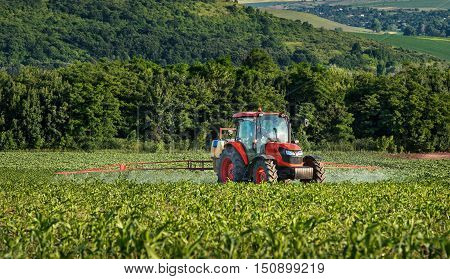 Varna Bulgaria - June 10 2016: Kubota tractor in field. Kubota Corporation is a Japanese heavy equipment manufacturer with an array of products such as tractors and agricultural equipment.