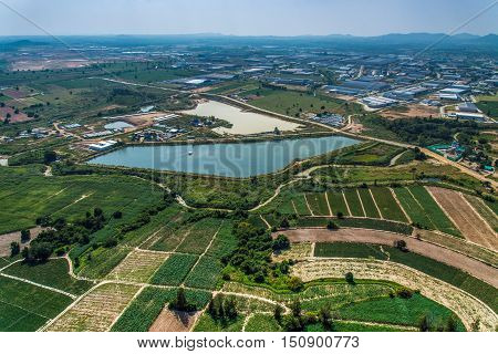 Industrial estate land development Farmland water reservoir aerial view