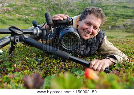 a woman with a camera photographing nature