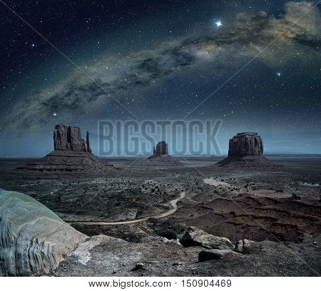 panoramic view of the milky way in monument valley