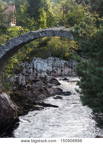 The old stone Packhorse Bridge in Carrbridge, Scotland