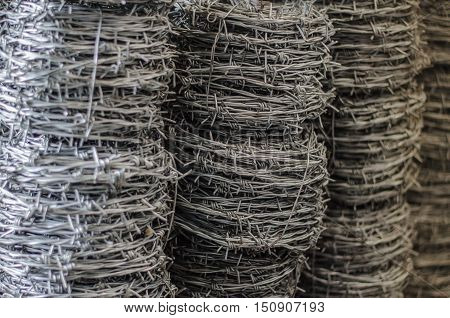 barbed wire roll  iron, isolation, jail close up