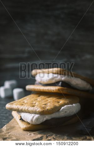 Smores on the wooden table vertical melted, blur, blurred