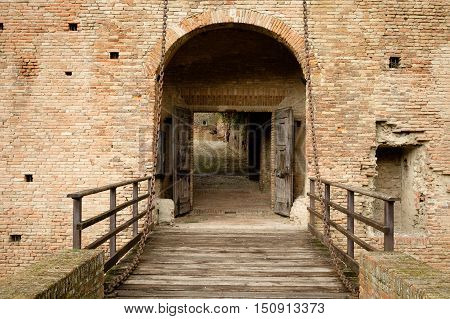 Entrance detail with drawbridge of the famous castle of Imola in Italy