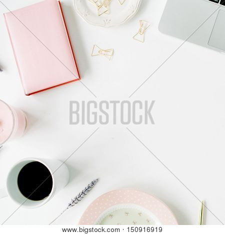 Flat lay fashion feminine home office workspace. Laptop pink diary coffee golden pen and clips. Top view