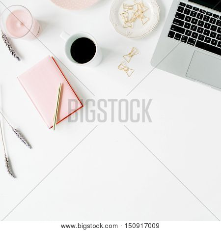 Flat lay fashion feminine home office workspace. Laptop pink teapot golden pen and clips. Top view