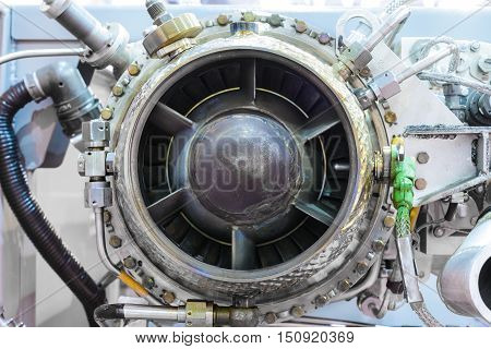 The gas-turbine auxiliary power unit. View from the air turbine. Nuts connecting tubes, nozzles, combustion chamber insulation.