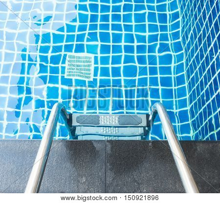 Swimming pool with stair on top view.