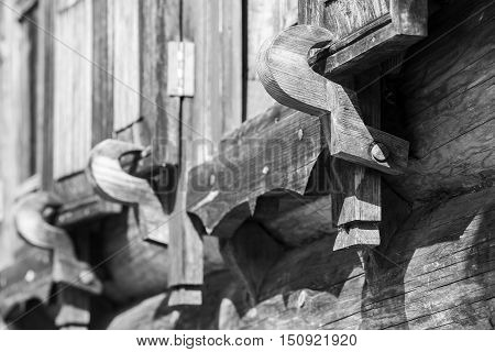 Wooden shutters latch. Traditional rural Russian architectural details. Close up black and white photo with selective focus