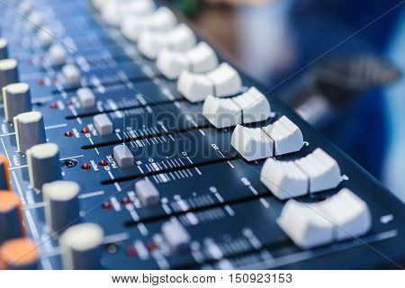 Regulators mixer close-up. Shallow depth of field. Mixing console. Sound mixer. Live and studio equipment