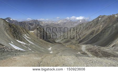 Stone valley over the glacier in the upper reaches of the Creek Shavoursoy. The Western Tien-Shan. Uzbekistan
