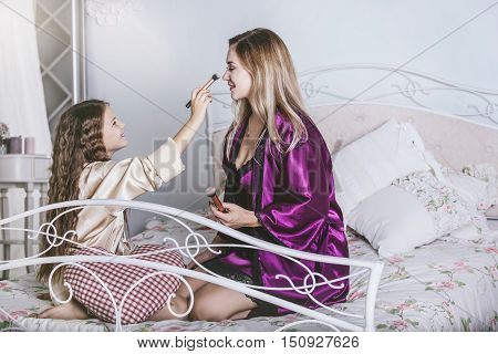 Mother And Daughter Alone At Home Beautiful, Fashionable And Fun. Happy Loving Family.