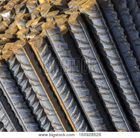 Background texture of steel rods used in construction to reinforce concrete