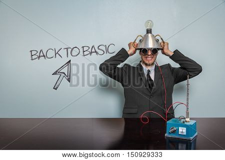 Back To Basic text with vintage businessman and machine at office