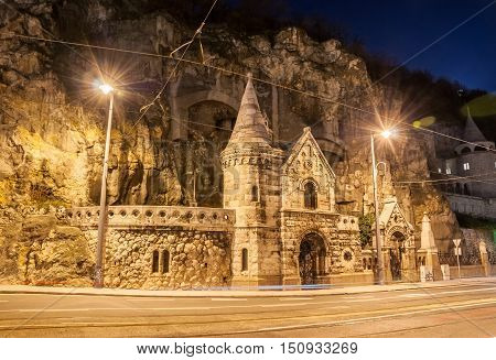 Facade Of The Cave Church With Lens Flares Located Inside Gellert Hill In Budapest