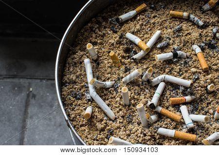the cigarettes in bin of the public