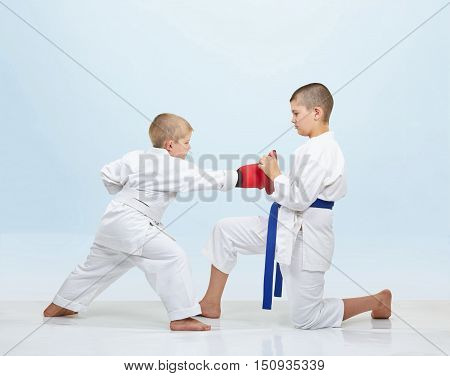 Boy karateka beats punch on fitness machine that brother keeps