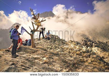 HIGH TATRA MOUNTAINS - SEPTEMBER 15 2016: Resting tourists on mountain pass in High Tatra Slovakia.