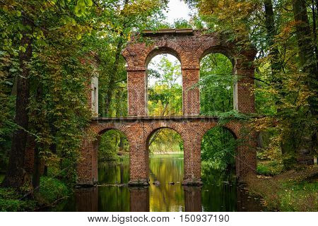 Arkadia Poland - September 30 2016: Aqueduct in the sentimental and romantic Arkadia park near Nieborow Central Poland Mazovia. Garden in the English style