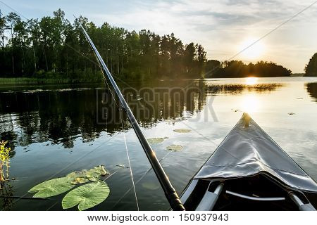 Fishing for bait with boats on the lake during sunset