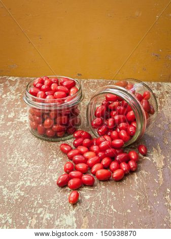 Red berries in glass jars ready for preserve