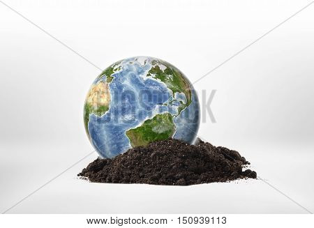 Close-up planet Earth on a ground. Environmental issues. Natural resources. Ecosystem. Elements of this image are furnished by NASA.