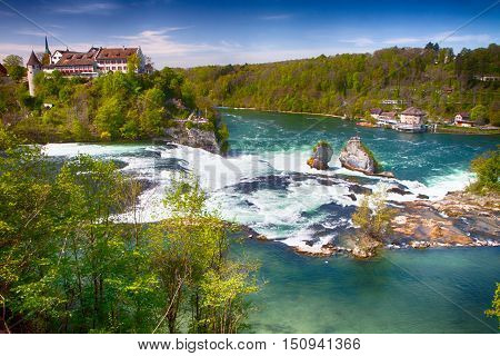 View to Rhine falls near Schaffhausen Switzerland. Rhine falls is the largest plain waterfall in Europe.