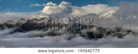 Snow-covered mountain tops at sunrise. Greater Caucasus Mountain Range. Caucasus mountains. Karachay-Cherkessia. Russia.