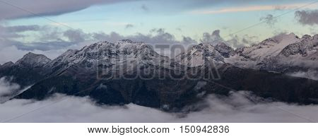 Greater Caucasus Mountain Range in morning twilight. Caucasus mountains. Karachay-Cherkessia. Russia.
