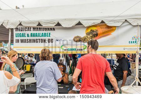 Washington DC, USA - September 24, 2016: Cannx Medical marijuana booth and sign at VegFest vegan vegetarian festival with people