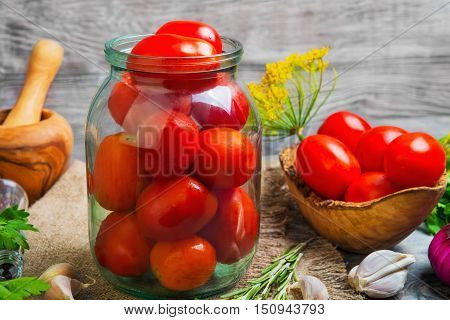 Canning pickling Preserving tomatoes herbs for canning pickling rosemary dill parsley pepper onion. Fresh vegetables for Preserving tomatoes gray wooden background.