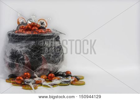 hallowen candy with cobwebs on a white background with candies.