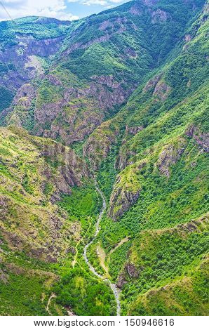The aerial view of Vorotan river canyon with steep rocky slopes Tatev Syunik Province Armenia.