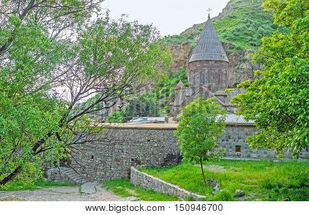 The garden at the fortress wall of Geghard Monastery medieval complex that originates from the Holy Spear Kotayk Province Armenia.
