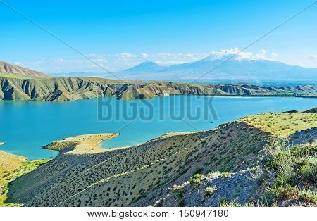 The Azat Reservoir is one of the most scenic locations in Ararat Province with indented bank line and view on hazy Ararat Mount Armenia.