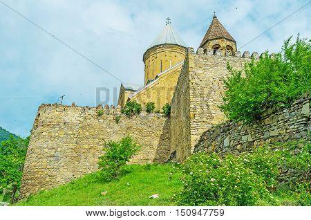 The massive ramparts of Ananuri fortress located at the Georgian Military Road in Mtskheta-Mtianeti Region Georgia.