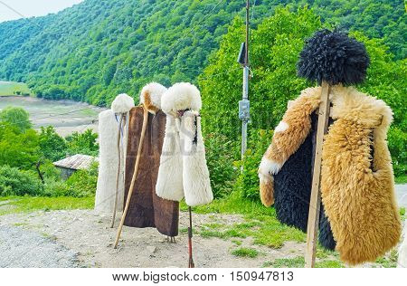 The Georgian shepherds' costume - the hat (papakha) and coat of sheep's fur are the best choice for cold mountain weather Ananuri Georgia.