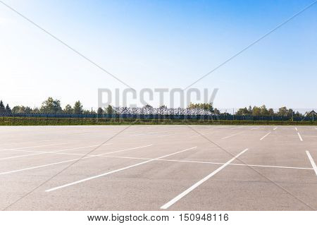 the empty outdoor car park lots and blue sky