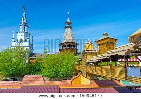 The red roofs of souvenir market in Izmailovo also famous as Vernissage and the towers of Izmailovsky Kremlin the cultural center of arts and crafts Moscow Russia.