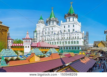 MOSCOW RUSSIA - MAY 10 2015: The white luxury mansion rising above the Izmailovsky Vernissage Market houses the hotel offering apartments with the view on Izmailovsky Kremlin on May 10 in Moscow.
