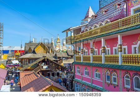 MOSCOW RUSSIA - MAY 10 2015: The carved timbered and colorful painted mansions in Izmailovsky Market represent the different periods of architecture in Russia on May 10 in Moscow.
