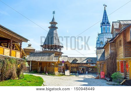 MOSCOW RUSSIA - MAY 10 2015: The Izmailovsky Kremlin contains a lot of museums craft centers and cafes partly located in traditional timbered buildings named izba on May 10 in Moscow.
