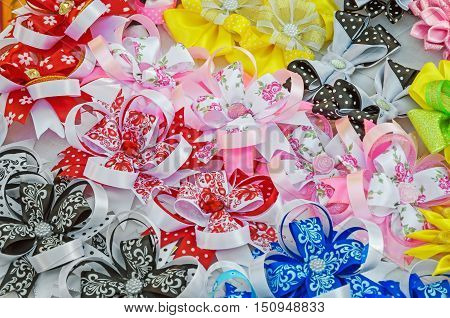 Multicolored hair ornament handmade of satin ribbons of different colors