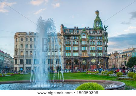 ST PETERSBURG RUSSIA - OCTOBER 3 2016. Zinger House on Nevsky Prospect and fountain on Kazan square on the foreground. Autumn sunset in St Petersburg center Russia. Architecture view