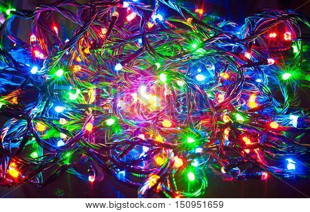 Abstract background green red yellow and blue colors. Electric Christmas garland.