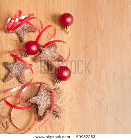 Christmas sweet cookies red ribbon and Christmas decoration on wooden table