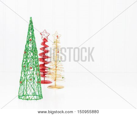 Three colorful stylized christmas trees with ample copy space included.