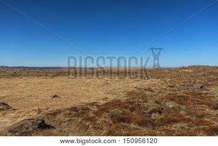 Large electricity pylons near the city Reykjavik