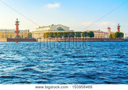 Panorama of Vasilievsky island spit of St Petersburg Russia - rostral columns Stock exchange building and Custom house in St Petersburg Russia. Architecture landscape of St Petersburg in sunny day